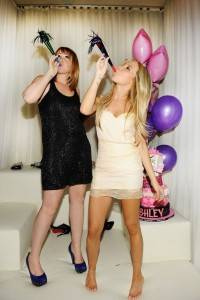 Jennifer Tisdale (L) and her sister Ashley Tisdale (R) celebrate Ashley's 26th birthday at Pure Nightclub.