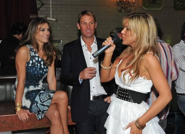 Singer Olya serenades Elizabeth Hurley and Shane Warne at Savile Row.