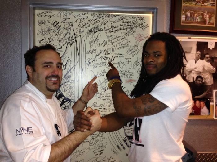 Chef Barry Dakake and Richard Sherman with the shakedown door.