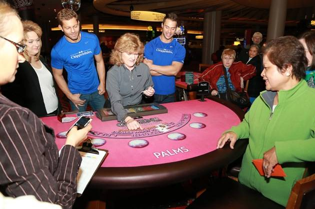 Jaymes and James Oversee the Blackjack Hand. Photos: Edison Graff