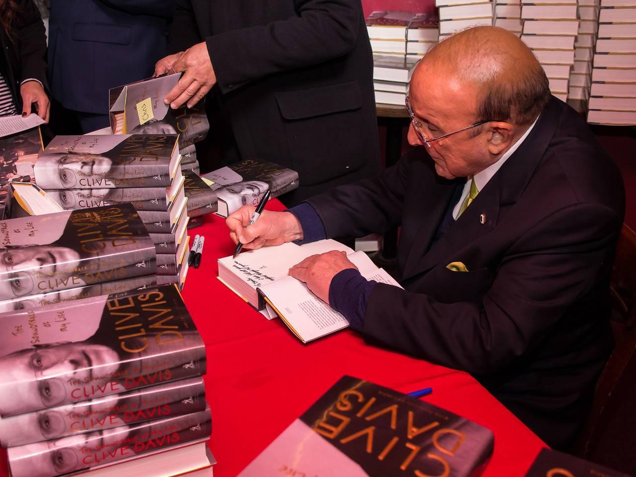 Clive Davis signing his new book at Beach Blanket Babylon.  Photo Credit (all): Rick Markovich