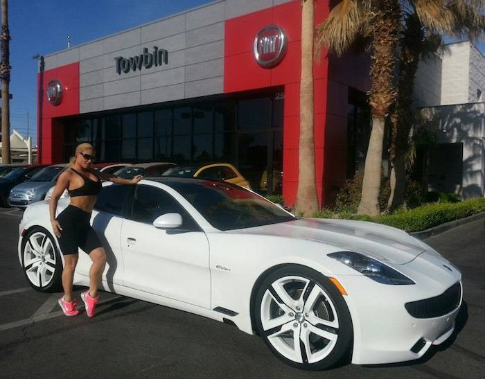 Coco Austin with her new, specially ordered Fisker Karma at Towbin Automotive.