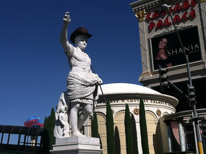 Caesar Augustus, first Emperor of the Roman Empire, welcomes guests in his cowboy best at the main entrance to Caesars Palace. Photo: Caesars Entertainment