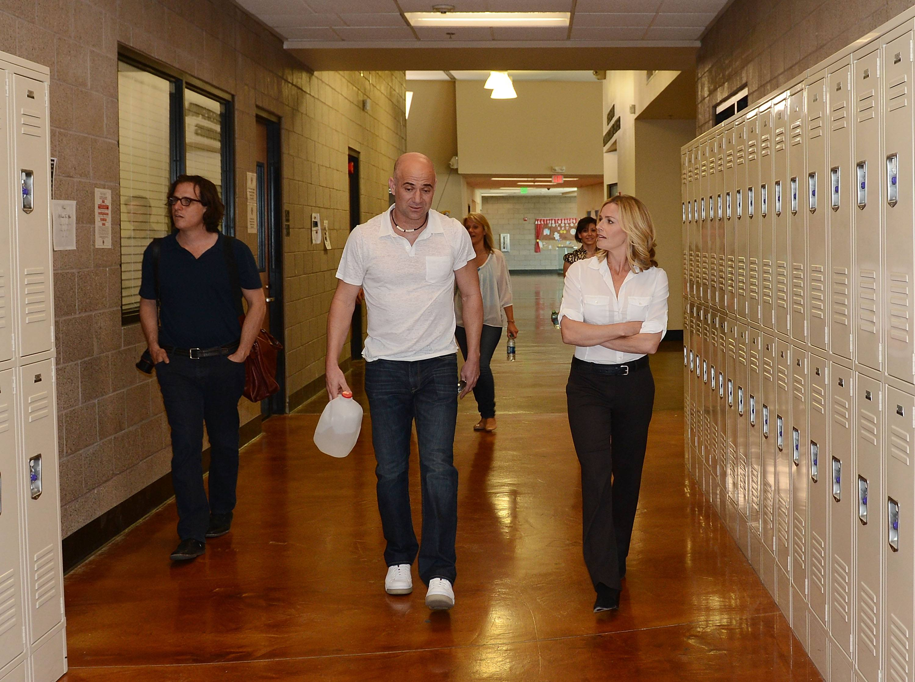 Andre Agassi (C) gives Davis Guggenheim (L) and Elisabeth Shue (R) a tour of the Andre Agassi College Preparatory Academy. Photos: Denise Truscello/WireImage
