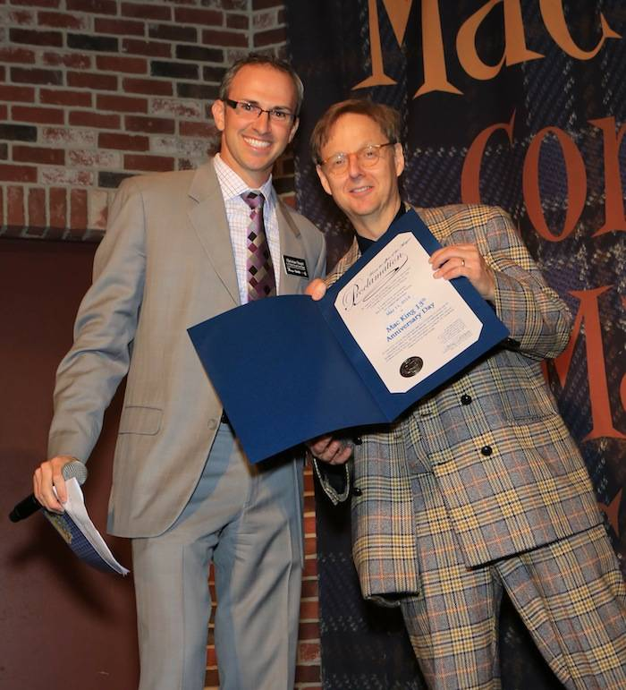 "Christian Stuart, Harrah's regional vice president and assistant general manager presents Comedy-Magician Mac King with a proclamation from Mayor Carolyn G. Goodman naming May 11, 2013 ""Mac King 13th Anniversary Day"" in Las Vegas. Photos: Gabe Ginsberg"