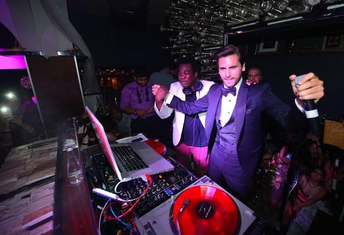 Scott Disick raps with DJ Reach at Hyde Bellagio. Photo: Jeff Bottari/Getty