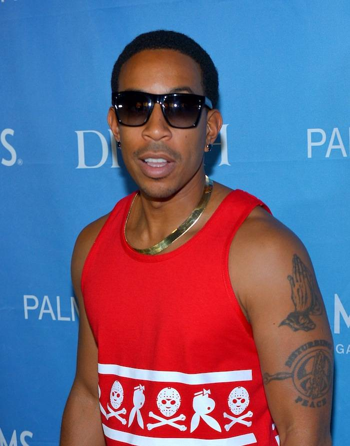 Ludacris poses on the red carpet at Ditch Fridays pool party. Photos: Bryan Steffy/WireImage