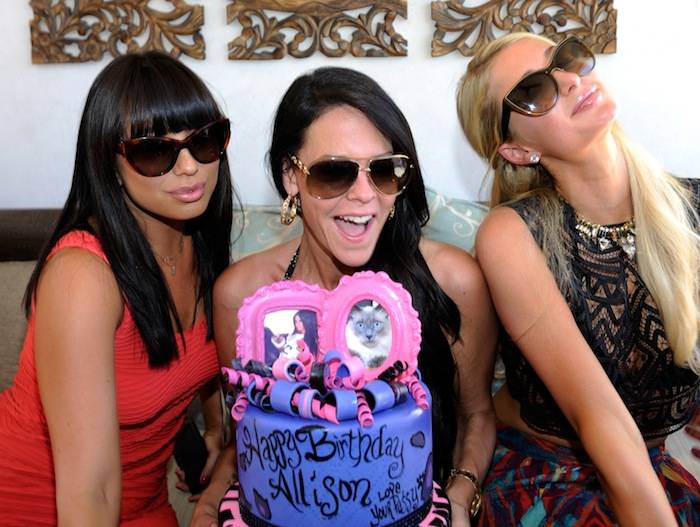 Cheryl Burke, Allison Melnick and Paris Hilton at Daylight Beach Club. Photos: David Becker/WireImage