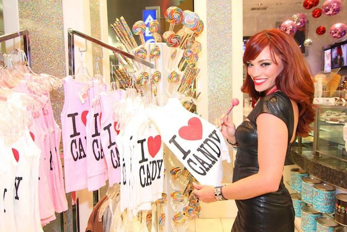 Jessica Sutta looks at retail merchandise at Sugar Factory's Goblet Bar. Photos: Jeff Ragazzo