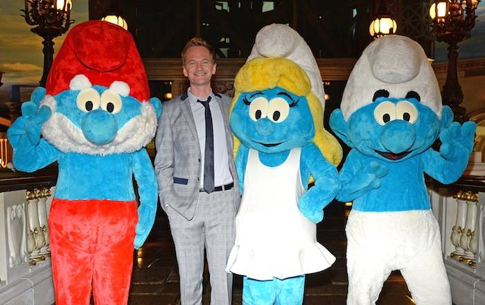 """Actor Neil Patrick Harris poses with (L-R) Papa Smurf, Smurfette and Clumsy Smurf characters from Columbia Pictures and Sony Pictures Animation movie """"The Smurfs 2"""" at the Eiffel Tower Experience bridge at Paris Las Vegas. Photos: Ethan Miller/Getty Images"""