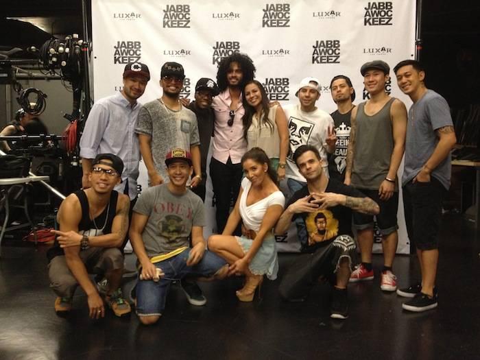 Anjelah Johnson and the cast of Jabbawockeez.