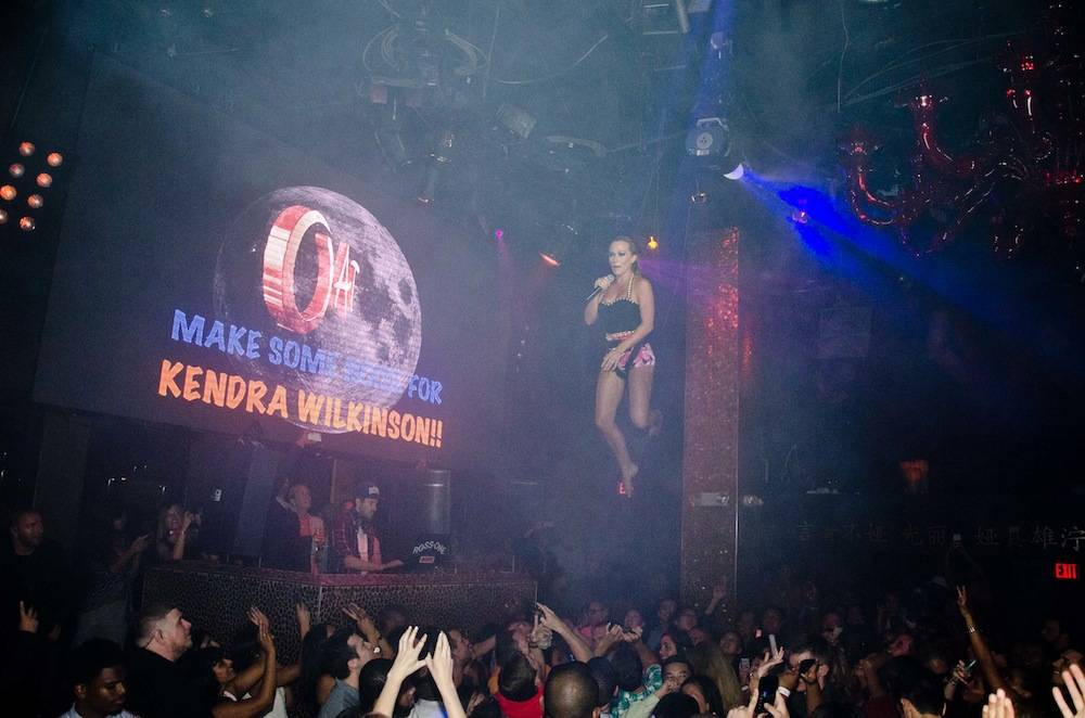 Kendra Wilkinson-Basked plays bottle fairy at Tao. Photos: Karl Larson/Powers Imagery
