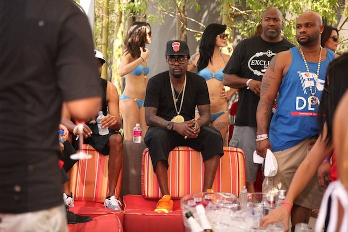 Wale hangs out at private table at Palms Pool after his Ditch Fridays performance. Photos: Joe Fury