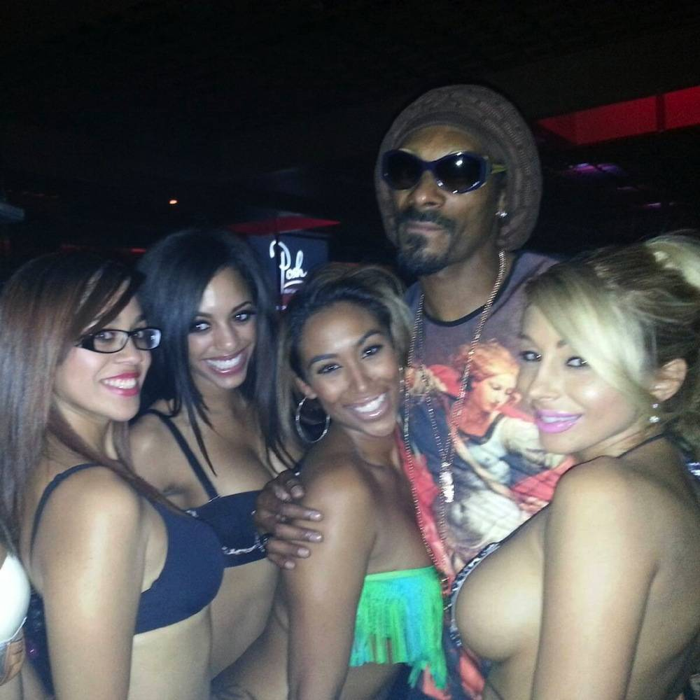 Snoop Lion and Crazy Horse III entertainers inside Posh Boutique Nightclub.