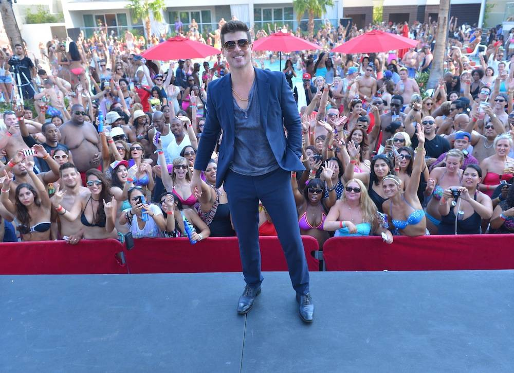 Robin Thicke poses with thousands of screaming fans after performing for Ditch Fridays partygoers. Photos: Bryan Steffy/WireImage