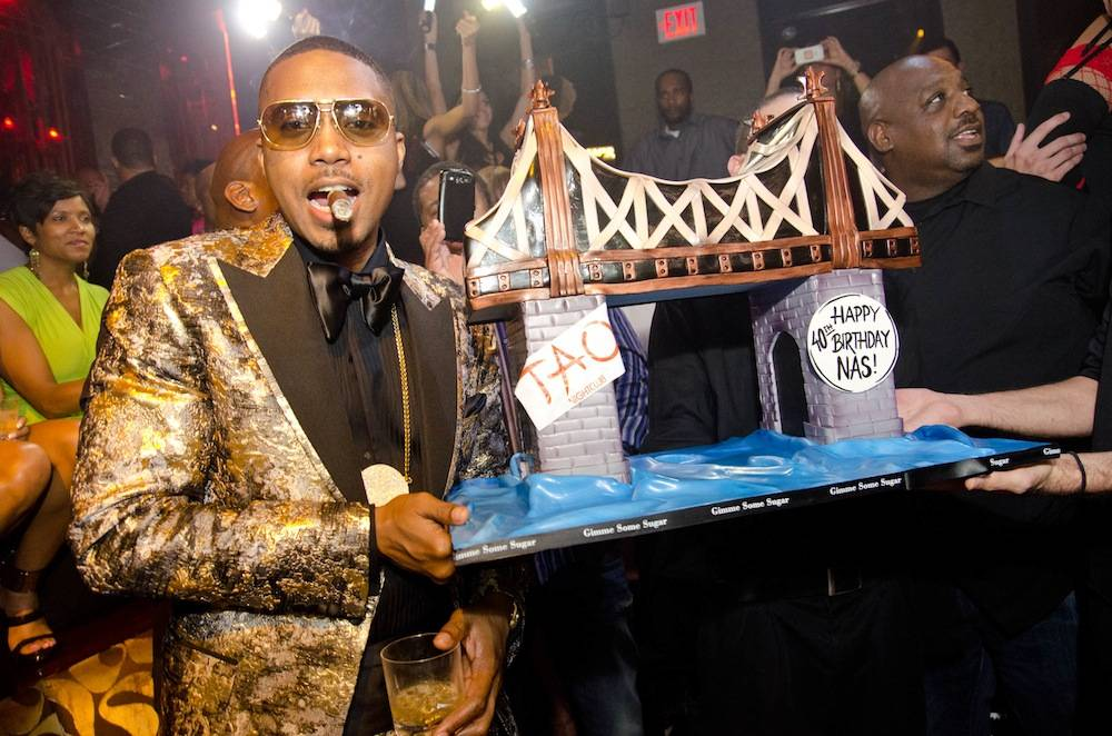 Nas with his birthday cake from Gimme Some Sugar. Photos: Karl Larson/Powers Imagery