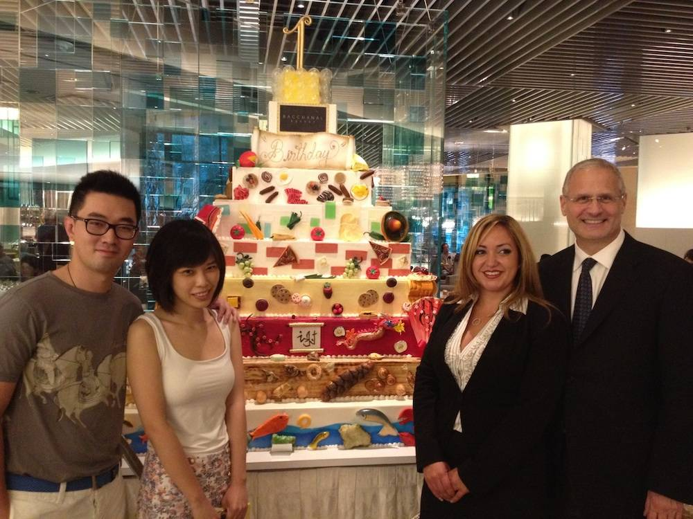 Yao Cheng, One-Millionth Guest Tianshu Sun, General Manager of Bacchanal Gabrielle Perez and President of Caesars Palace Gary Selesner in front of Bacchanal birthday cake at Bacchanal Buffet at Caesars Palace.