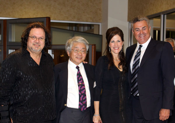 Miami surreal artist-photographer Claudio Lovo and world-renowned automotive artist Shin Yoshikawa with Craig and Martine Zinn of the Craig Zinn Automotive Group