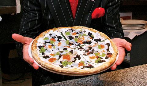 ninoholdingpizza.jpg