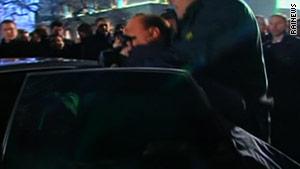 Photo of Berlusconi after attack via CNN.com